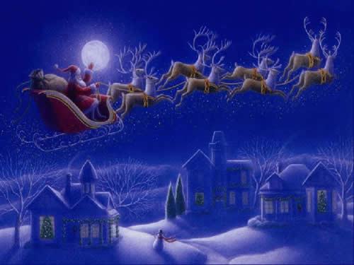 Immagini di Natale Babbo Natale con le renne volanti