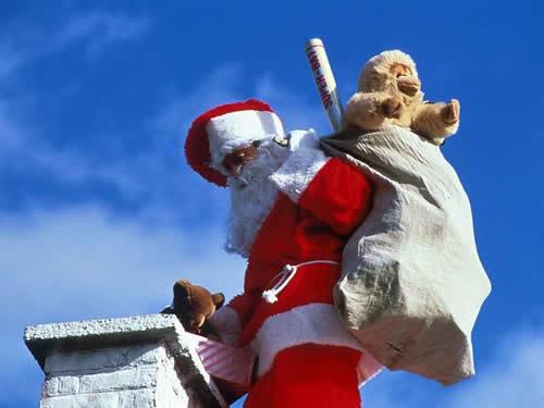Immagini di Natale Babbo Natale sul tetto