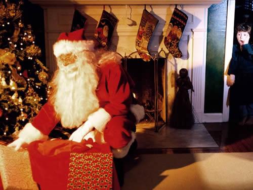 Immagini di Natale Babbo Natale consegna i doni